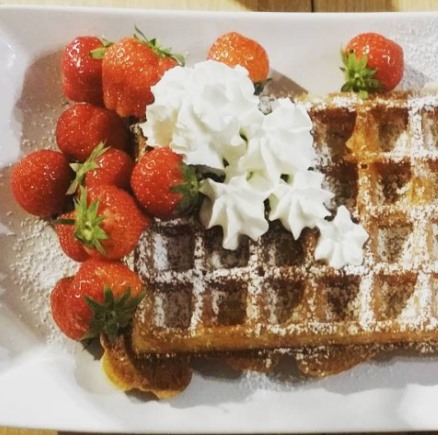 perfect belgian waffle with cream and strawberies